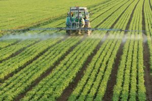 tractor watering crops